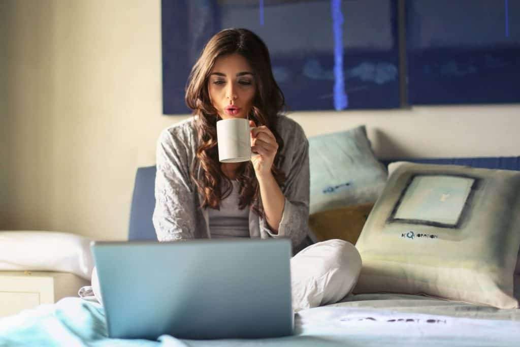 Woman Real Estate Agent Drinking Coffee Website